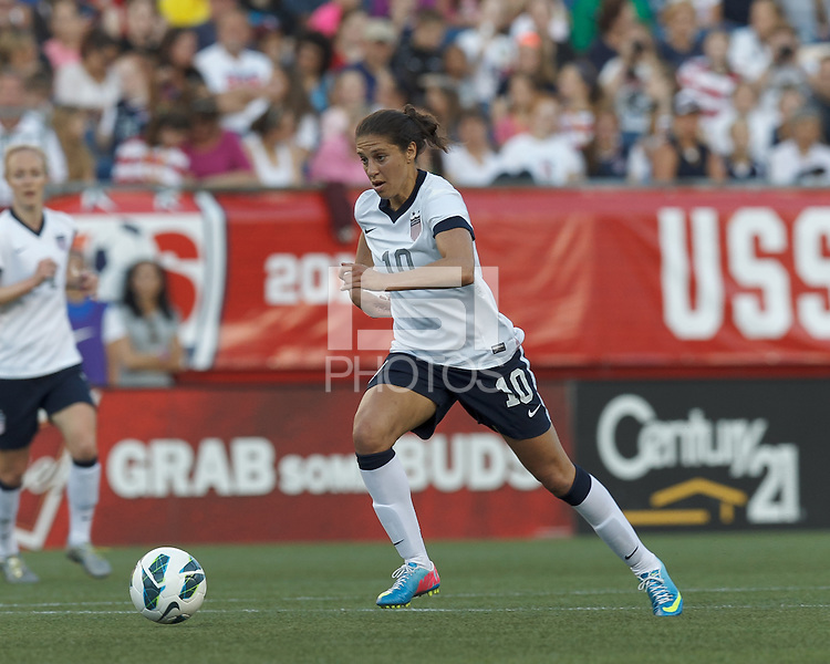 USWNT midfielder Carli Lloyd (10) on the attack.  In an international friendly, the U.S. Women's National Team (USWNT) (white/blue) defeated Korea Republic (South Korea) (red/blue), 4-1, at Gillette Stadium on June 15, 2013.