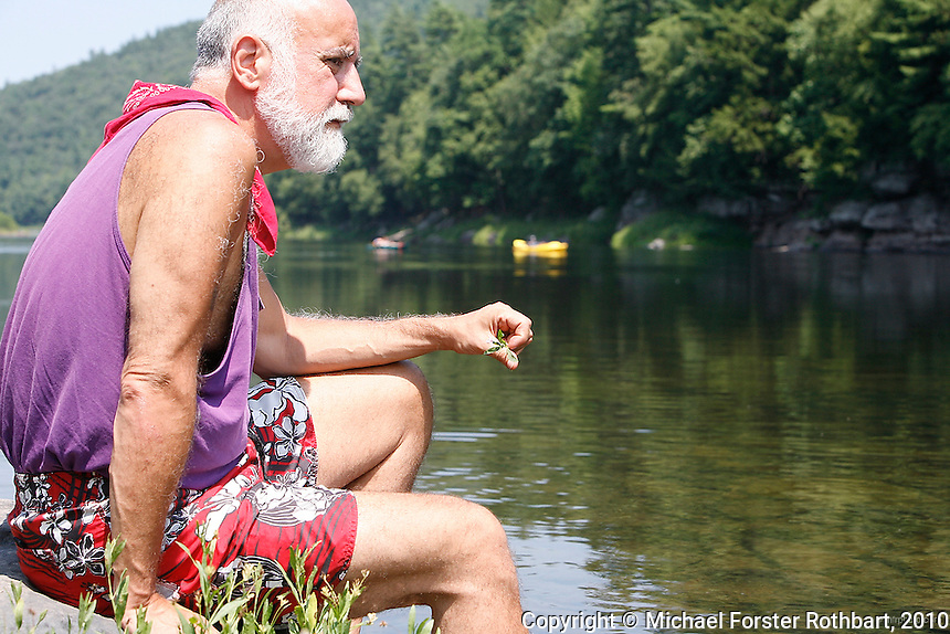Environmental activist Pat Carullo looks over the Upper Delaware River near his home in Lackawaxen, PA. Carullo is a member of Damascus Citizens for Sustainability (www.damascuscitizens.org), a non-profit group fighting natural gas drilling in the Delaware River watershed. &quot;Look at this,&quot; says Carullo, &quot;New York City drinking water, Philadelphia drinking water. The idea of 35,000 wells in these hills, the idea of it kills me.&quot; <br /> <br /> The Upper Delaware Scenic and Recreational River, part of the National Park Service's Wild and Scenic Rivers System, stretches 73.4 miles along the New York - Pennsylvania border.<br /> <br /> Hydraulic fracturing or &quot;fracking&quot; is new method of drilling for natural gas: millions of gallons of water, sand and proprietary chemicals are pumped down a well under high pressure. The pressure fractures the shale, opening fissures so that natural gas can flow more freely. In August 2010, fracking is being widely used in the Marcellus Shale formation under Pennsylvania while New York considers a moratorium until the environmental effects can be reviewed. <br /> <br /> The 2005 Energy Policy Act exempted natural gas drilling from the Safe Drinking Water Act, and exempts companies from disclosing the chemicals used during fracking. Scientists have identified volatile organic compounds (VOCs) such as benzene, ethylbenzene, toluene, methane and xylene that have been found in contaminated drinking water near drilling sites. Other environmental concerns include surface water contamination, air pollution, forest fragmentation, plus human health problems. On the other hand, gas companies and property owners stand to earn up to one trillion dollars in profits from drilling in the Marcellus Shale.<br /> <br /> &copy; Michael Forster Rothbart<br /> www.mfrphoto.com <br /> 607-267-4893 o 607-432-5984<br /> 5 Draper St, Oneonta, NY 13820<br /> 86 Three Mile Pond Rd, Vassalboro, ME 04989<br /> info@mfrphoto.com<br /> Photo by: Michael Forster Rothbart<br /> Date: 8/2010    File#:  Canon 5D digital camera frame 68187