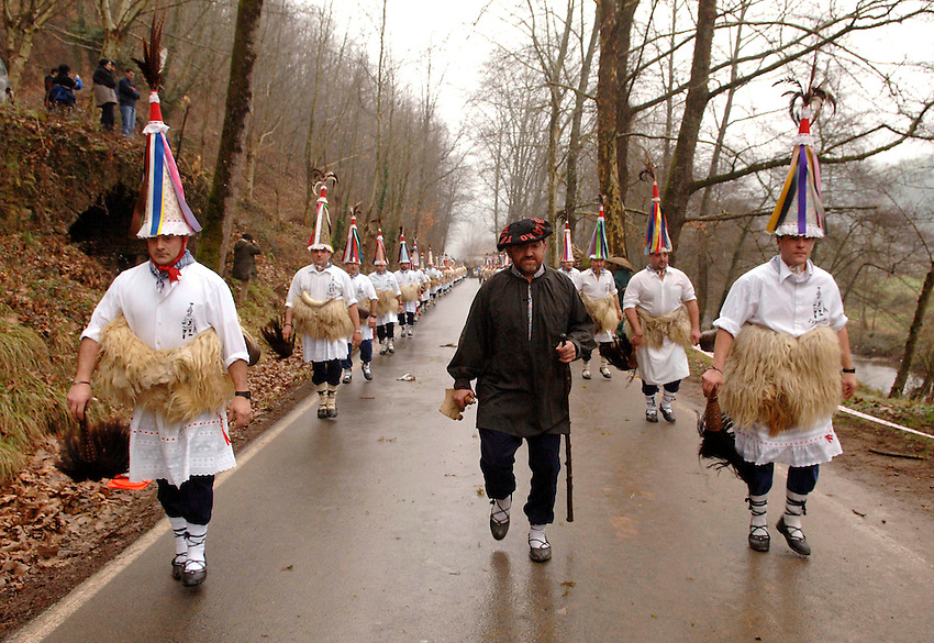ZUBIETA, NAVARRE- JANUARY 31: A group of 'Zanpantzar', people dressed in sheep fur and big cowbells tied to their back, march across Zubieta village during an ancient traditional carnival on January 31, 2006. Zanpantzar´s march trough Zubieta farmhouses and streets sounding their cowbells to wake up the earth for a good new farmer year and keep far away all bad spirits . Photo by Ander Gillenea