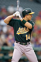 Oakland Athletics second baseman Mark Ellis (14) at bat against the Texas Rangers in American League baseball on May 11, 2011 at the Rangers Ballpark in Arlington, Texas. (Photo by Andrew Woolley / Four Seam Images)