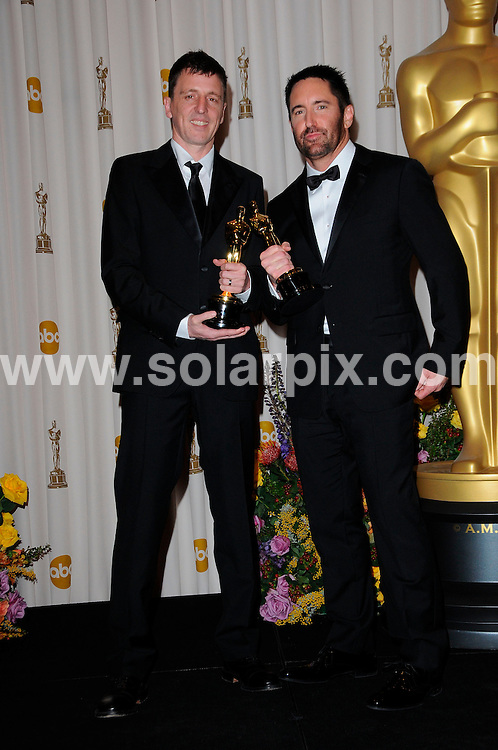 **ALL ROUND PICTURES FROM SOLARPIX.COM**                                             **SYNDICATION RIGHTS FOR UK, AUSTRALIA, DENMARK, PORTUGAL, S. AFRICA, SPAIN & DUBAI (U.A.E) & ASIA (EXCLUDING JAPAN) ONLY**                                                                                  83rd Annual Academy Awards Press Room, Kodak Theatre, Hollywood, CA, USA.                                                                        .This pic:    Atticus Ross and Trent Reznor.JOB REF:    12900    PHZ/Evans       DATE: 27.02.11                                                           **MUST CREDIT SOLARPIX.COM OR DOUBLE FEE WILL BE CHARGED**                                                                      **MUST AGREE FEE BEFORE ONLINE USAGE**                               **CALL US ON: +34 952 811 768 or LOW RATE FROM UK 0844 617 7637**