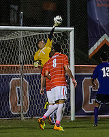 The number 24 ranked Furman Paladins took on the number 20 ranked Clemson Tigers in an inter-conference game at Clemson's Riggs Field.  Furman defeated Clemson 2-1.  Sven Lissek (1) tips a shot over the net.