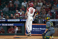 Heston Kjerstad (18) of the Arkansas Razorbacks reacts after having been hit by a pitch during the game against the Baylor Bears in game nine of the 2020 Shriners Hospitals for Children College Classic at Minute Maid Park on March 1, 2020 in Houston, Texas. The Bears defeated the Razorbacks 3-2. (Brian Westerholt/Four Seam Images)