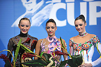 (L-R) Vera Sesina (silver), Evgeniya Kanaeva (gold) of Russia and Anna Bessonova (bronze) of Ukraine are winners in All Around at 2009 Pesaro World Cup on May 1, 2009 at Pesaro, Italy.  Photo by Tom Theobald.