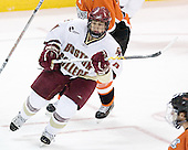 Nathan Gerbe 9 of Boston College turns up ice. The Eagles of Boston College defeated the Falcons of Bowling Green State University 5-1 on Saturday, October 21, 2006, at Kelley Rink of Conte Forum in Chestnut Hill, Massachusetts.<br />