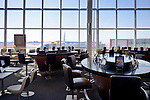 Airport restaurant tables equipped with Apple iPad tablets. Toronto Pearson International Airport.