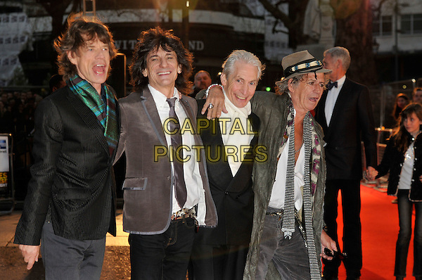 """MICK JAGGER, RONNIE WOOD, CHARLIE WATTS, KEITH RICHARDS of.The Rolling Stones.Attend the UK Film Premiere of director Martin Scorsese's  """"Shine A Light"""" documentary The Rolling Stones, held at Odeon cinema, Leicester Square, London, England, 2nd April 2008..half length band rockumentary suit jackets ties hat black grey green striped white cream funny mouth open .CAP/PL.©Phil Loftus/Capital Pictures."""