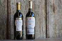 Marques de Riscal Rioja red wine bottles, Gran Reserva 2004 and Reserva 2007 vintage by old oak panel, Spain
