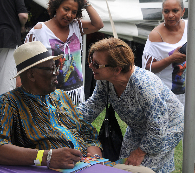 Randy Weston, signing autographs and posing with fans at the Annual Jazz in the Valley Festival,  in Waryas Park in Poughkeepsie, NY, on Sunday, August 21, 2016. Photo by Jim Peppler. Copyright Jim Peppler 2016 all rights reserved.