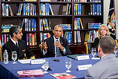United States President Barack Obama, center, speaks while participating in a roundtable discussion on the impacts of climate change on public health with Vivek Murthy, U.S. surgeon general, left, and Charlotte Wallace, sustainability coordinator at Anne Arundel Medical Center, at Howard University in Washington, D.C., U.S., on Tuesday, April 7, 2015. The President is warning that climate change will start affecting Americans' health in the near future and he is recruiting top technology companies to help prepare the nation's health systems.<br /> Credit: Andrew Harrer / Pool via CNP