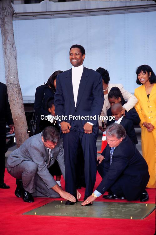 "©KATHY HUTCHINS/HUTCHINS.1/15/98 "" DENZEL WASHINGTON HAND & FOOT IMPRINTS "".DENZEL WASHINGTON"