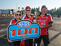 Nov 11, 2018; Pomona, CA, USA; NHRA comp eliminator driver David Rampy celebrates with crew after winning the Auto Club Finals at Auto Club Raceway. The win was the 100th national event victory of his career. Mandatory Credit: Mark J. Rebilas-USA TODAY Sports