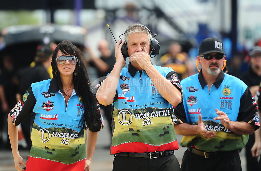 Apr. 30, 2011; Baytown, TX, USA: NHRA funny car crew members Randi Thiel (left) and Jason Sharp (center) during qualifying for the Spring Nationals at Royal Purple Raceway. Mandatory Credit: Mark J. Rebilas-