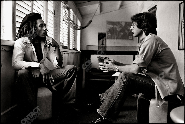 Bob Marley at home in Kingston, Jamaica being interviewed by David DeVoss.  Originally photographed by David Burnett while on assignment for TIME magazine.  March 1976.