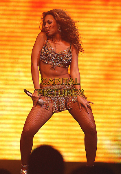 BEYONCE KNOWLES.Performs at the Final show of The Verizon Ladies First Tour 2004 held at The Pond of Anaheim in Anaheim,California on .April 21,2004.full length, full-length, belly, stomach, midriff, concert, live, music, gig, dancing.www.capitalpictures.com.sales@capitalpictures.com.Supplied By Capital Pictures