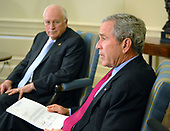 Washington, D.C. - June 20, 2007 -- United States President George W. Bush makes remarks on the federal budget during a meeting of the United States House Republican leaders in the Oval Office of the White House in Washington, DC on Wednesday, June 20, 2007.  Vice President Dick Cheney looks on from left.<br /> Credit: Ron Sachs  - Pool via CNP