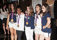 Aly Raisman, Gabby Douglas, McKayla Maroney, Kyla Ross and Jordyn Wieber of The gold medal-winning US Women's Gymnastics Team, the 'Fierce 5', flip the switch and light the Empire State Building's world-famous tower lights red, white and blue in honor of Team USA's success at the 2012 Olympic Game  in London. New York City, August 14, 2012. © Diego Corredor/MediaPunch Inc. /NortePhoto.com<br />