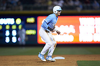 Michael Busch (15) of the North Carolina Tar Heels takes his lead off of second base against the South Carolina Gamecocks at BB&T BallPark on April 3, 2018 in Charlotte, North Carolina. The Tar Heels defeated the Gamecocks 11-3. (Brian Westerholt/Four Seam Images)