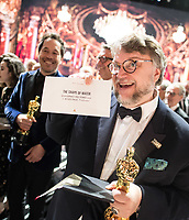 Guillermo del Toro accepts the Oscar&reg; for best motion picture of the year for work on &ldquo;The Shape of Water&rdquo; during the live ABC Telecast of The 90th Oscars&reg; at the Dolby&reg; Theatre in Hollywood, CA on Sunday, March 4, 2018.<br /> *Editorial Use Only*<br /> CAP/PLF/AMPAS<br /> Supplied by Capital Pictures