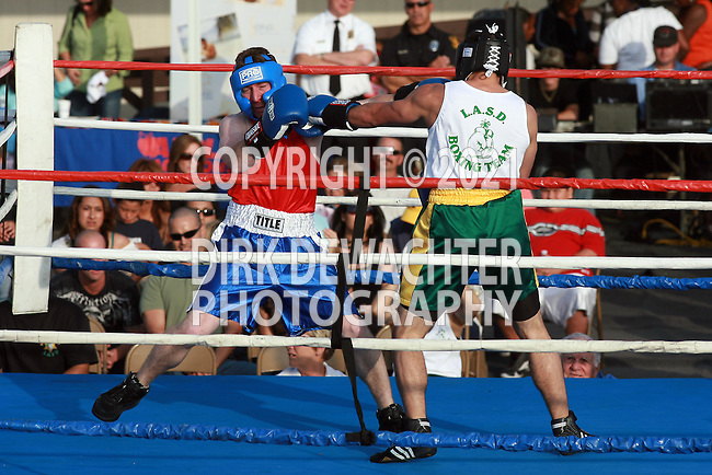 """Whittier, CA 05/10/08 - Frank Baker of the Los Angeles County Fire Department (in red shirt and blue trunks) boxes against Los Angeles County Sheriff's Department's Jonathan """"Toughman"""" Soler during the LASD boxing event held at the Los Angeles County Sheriff's Academy in Whittier."""