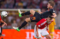 Netherlands' KIaas Jan Huntelaar (top) and Hungary's Zoltan Liptak (bottom) fight for the ball during a World Cup 2014 qualifying soccer match Hungary playing against Netherlands in Budapest, Hungary on September 11, 2012. ATTILA VOLGYI