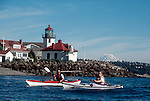 Sea Kayakers, Seattle, Mount Rainier, sea kayaking couple paddle past Alki Point, West Seattle, Washington State, Puget Sound, Pacific Northwest, USA,.