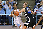 02 March 2014: North Carolina's Diamond DeShields (left) is fouled by Duke's Tricia Liston (32). The University of North Carolina Tar Heels played the Duke University Blue Devils in an NCAA Division I women's basketball game at Carmichael Arena in Chapel Hill, North Carolina. UNC won the game 64-60.