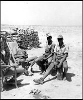 BNPS.co.uk (01202 558833)Pic:    Pen&Sword/BNPS<br /> <br /> Officers in the field rest on Italian deckchairs from a Libyan beach in 1942.<br /> <br /> Fascinating rare photos of Rommel's feared Afrika Korps which terrorised the Allies in the desert have come to light in a new book.<br /> <br /> Under the direction of legendary German commander Field Marshal Erwin Rommel, who was nicknamed the Desert Fox, the corps were recognised as a superb fighting machine.<br /> <br /> They achieved their greatest triumph when they outmanoeuvred the British at the Battle of Gazala in June 1942 which led to them capturing Tobruk in Libya.<br /> <br /> But they were ultimately defeated in the iconic Battle of Alamein when they succumbed to an offensive led by Field Marshal Bernard Montgomery.