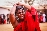 Africa,Ghana,Kumasi, Ashanti woman crying at funeral