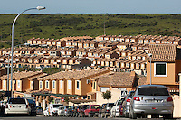 Rows of houses and rooftops, in a housing development, Algeciras, Andalusia, Spain.