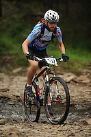 NWA Democrat-Gazette/ANDY SHUPE<br /> Daniel Christiansen of Fayetteville rides across Lee Creek Saturday, Sept. 19, 2015, during the Northwest Arkansas Mountain Bike Championships at Devil's Den State park.