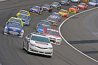 Kevin Harvick (#29) and Brad Keselowski (#2) lead the field back to the green flag.