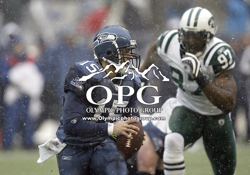 December 21, 2008:  Seattle Seahawks quarterback #15 Seneca Wallace scrambles out of the pocket against NY Jets at Quest Field in Seattle, WA.  Seattle won 13-3 over the NY Jets.