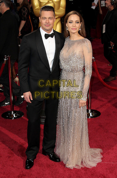 02 March 2014 - Hollywood, California - Brad Pitt, Angelina Jolie. 86th Annual Academy Awards held at the Dolby Theatre at Hollywood &amp; Highland Center. <br /> CAP/ADM/RE<br /> &copy;Russ Elliot/AdMedia/Capital Pictures
