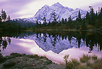 Mount Shuksan reflected in Picture Lake on a frosty autumn morning, Mount Baker Wilderness Area, North Cascades, Washington State.