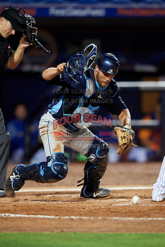 Charlotte Stone Crabs catcher Joey Roach (8) recovers a loose ball during the second game of a doubleheader against the St. Lucie Mets on April 24, 2018 at First Data Field in Port St. Lucie, Florida.  St. Lucie defeated Charlotte 5-3.  (Mike Janes/Four Seam Images)