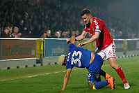 Jason Pearce of Charlton Athletic pushes Lyle Taylor of AFC Wimbledon over during the Sky Bet League 1 match between AFC Wimbledon and Charlton Athletic at the Cherry Red Records Stadium, Kingston, England on 10 April 2018. Photo by Carlton Myrie / PRiME Media Images.
