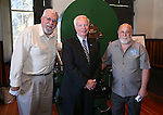 From left, Curator Bob Nylen, Nevada Museum and History Director Peter Barton and Coiner Ken Hopple pose following a ceremony for the final design in a commemorative Sesquicentennial series at the Nevada State Museum, in Carson City, Nev., on Wednesday, Sept. 3, 2014. <br /> Photo by Cathleen Allison