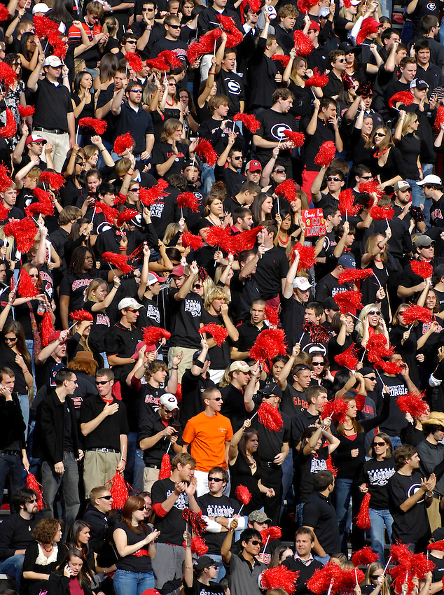FAN OF THE GAME  Donnie Hart, an Auburn student from Woodstock, Georgia wears his Auburn orange in a sea of red and black in the Georgia student section.  Auburn vs. Georgia at Athens, Georgia.  Bob Gathany  / The Huntsville TImes