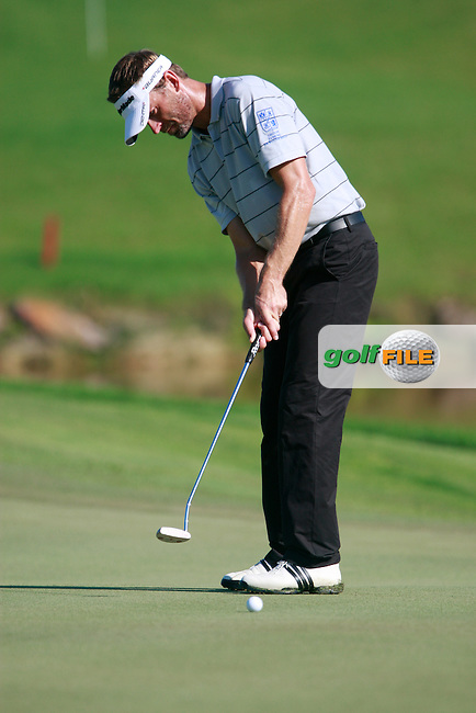 Raphael Jacquelin (FRA) takes his putt on the 14th green during Thursday's Round 1 of the 2011 Iskandar Johor Open, Horizon Hills Golf Club, Johor, Malaysia, 15th November 2011 (Photo Eoin Clarke/www.golffile.ie)