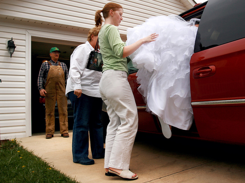 """Arrington's niece Cassie, or """"Bubba"""" as he refers to her, needs a little assistance getting her dress safely from the family's house to a bridal photo session.  Social events like these are more often than not planned by Arrington's wife Jane, who also runs the fruit market."""