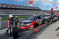 Denny Hamlin (#18) makes a pit stop.