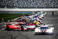 DAYTONA BEACH, FL - JAN 25:  The #77 Mazda DPi of Oliver Jarvis, of Great Britain, Tristan Nunez, and Olivier Pla, of France leads the crds off of pit road before the start of  the Rolex 24 at Daytona at Daytona International Speedway, Daytona Beach, Florida,  January 25, 2020. (Photo by Brian Cleary/BCPix.com)