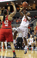 Virginia guard Faith Randolph (20) shoots over Maryland center Brionna Jones (42) during the game Thursday in Charlottesville, VA. Virginia defeated Maryland 86-72. Photo/The Daily Progress/Andrew Shurtleff