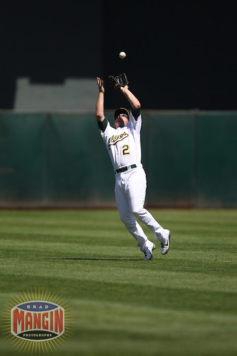 OAKLAND, CA - AUGUST 14:  Cliff Pennington #2 of the Oakland Athletics catches a pop up in center field against the Texas Rangers during the game at O.co Coliseum on August 14, 2011 in Oakland, California. Photo by Brad Mangin