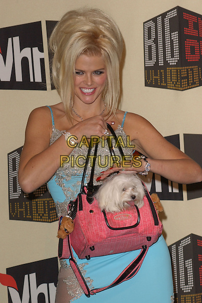 ANNA NICOLE SMITH.The VH1 Big in 04  Award Show held at The Shrine Auditorium in Los Angeles, California .December 1, 2004.half length, blue dress, bag, purse, animal, dog, pet, petting, gesture.www.capitalpictures.com.sales@capitalpictures.com.Supplied by Capital Pictures
