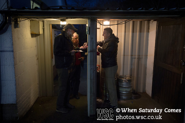 Gretna 0 Dalbeattie Star 0, 11/03/2016. Raydale Park, Lowland League. Spectators paying in at a turnstile at Raydale Park, before Gretna take on Dalbeattie Star in a Scottish Lowland League fixture which ended 0-0. The match was one of six arranged by the league and GroundhopUK over the weekend to accommodate groundhoppers, fans who attempt to visit as many football venues as possible. Around 100 fans in two coaches from England participated in the 2016 Lowland League Groundhop and they were joined by other individuals from across the UK which helped boost crowds at the six featured matches. Photo by Colin McPherson.