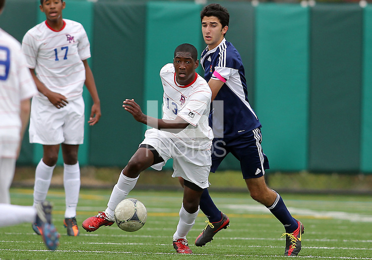 HYATTSVILLE, MD - OCTOBER 26, 2012:  Arion Sobers-Assue (13) of DeMatha Catholic High School breaks away from Arjan Ganji (10) of St. Albans during a match at Heurich Field in Hyattsville, MD. on October 26. DeMatha won 2-0.