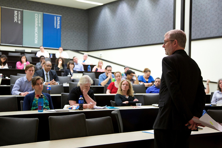 "The Rev. Dennis H. Holtschneider, C.M., president of DePaul, responds to staff questions as DePaul University's Staff Council met Monday, May 18, 2015, to  participate in a question and answer ""town hall"" meeting. (DePaul University/April Sumner)"