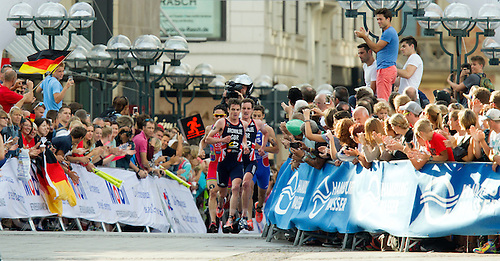12 JUL 2014 - HAMBURG, GER - Jonathan Brownlee (GBR) (left) from Great Britain leads the front pack of his brother Alistair Brownlee (GBR) (2nd from left), Vincent Luis (right) of France and series leader Javier Gomez (ESP) (left) from Spain during the run at the elite men's 2014 ITU World Triathlon Series round in the Altstadt Quarter, Hamburg, Germany (PHOTO COPYRIGHT © 2014 NIGEL FARROW, ALL RIGHTS RESERVED)